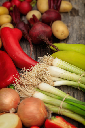 wooden surface: Various fresh raw vegetables on wooden surface