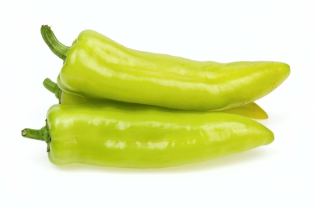 pointy: Pointy green peppers, on white background.