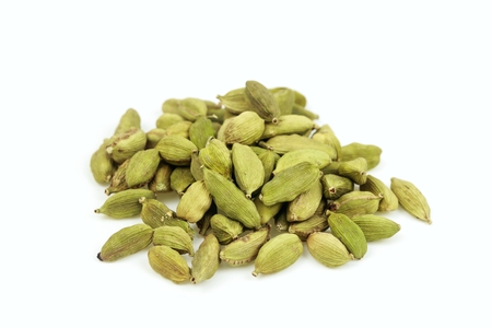cardamum: Dried cardamom pile on white background. Stock Photo