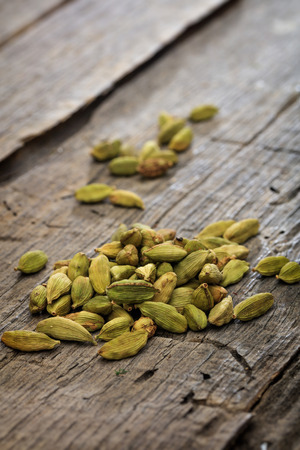 cardamum: Dried cardamom pile set on old wooden surface