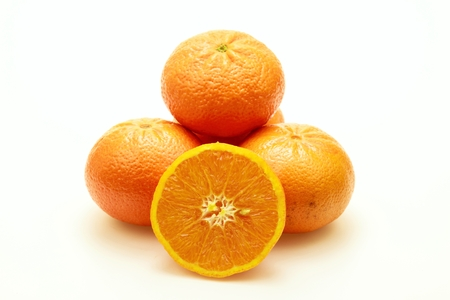 several: Close-up of several tangerines on white background.Isolated.