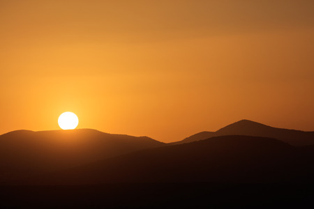 melancholic: Beautiful melancholic view on sunset over silhouette of mountains.Copy space