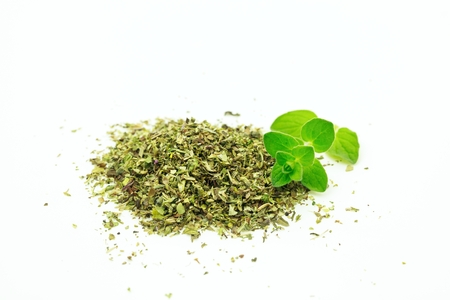 origanum: Bright green fresh origanum with dry on white background Stock Photo