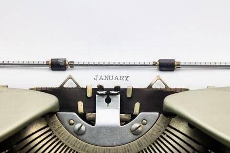 january: Close-up of word January on typewriter sheet Stock Photo
