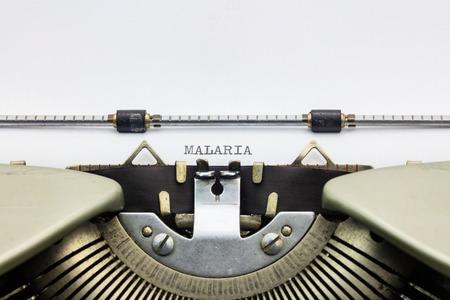 malaria: Close-up of word Malaria on typewriter sheet Stock Photo