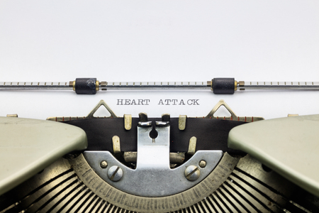 machinery space: Close-up of words Heart Attack on typewriter sheet Stock Photo