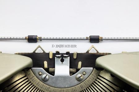 december: Close-up of word December on typewriter sheet