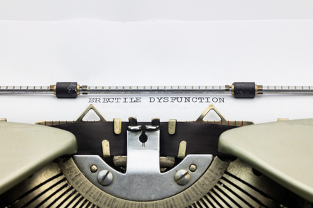dysfunction: Close-up of words Erectile dysfunction on typewriter sheet