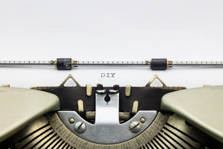 machinery space: Close-up of abbreviation DIY on typewriter sheet Stock Photo