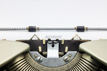 machinery space: Close-up of word Support  on typewriter sheet
