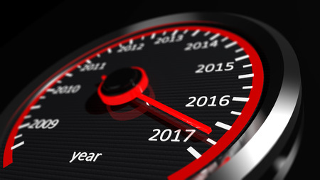 in years: 3D rendering of speedometer with 2017 closeup, on black background. Stock Photo