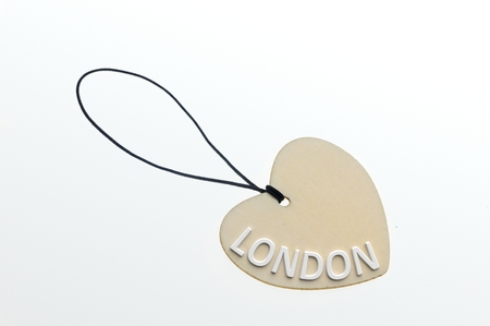 pasteboard: LONDON word on cardboard tag on white background.Isolated Stock Photo