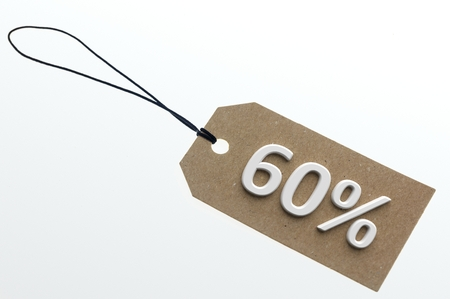 per cent: Close-up of 3d rendering 60 per cent discount on paper cardboard.Isolated Stock Photo