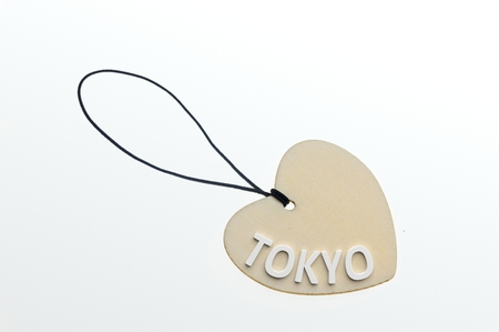 pasteboard: TOKYO word on cardboard tag on white background.Isolated