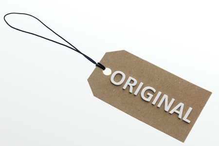 pasteboard: ORIGINAL word on cardboard tag on white background.Isolated