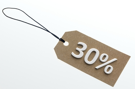 per cent: Close-up of 3d rendering 30 per cent discount on paper cardboard.Isolated Stock Photo