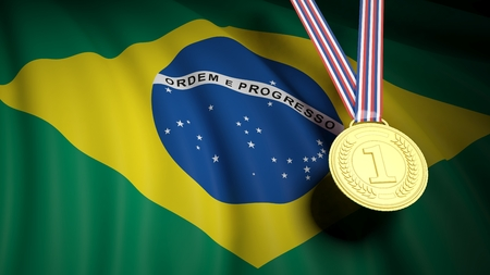 conquering: Close-up of golden first place medal against of Brazil national flag Stock Photo