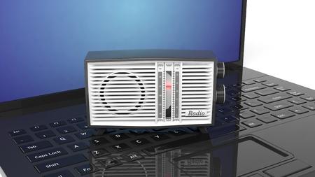 transistor: Antique radio transistor on laptops keyboard.3D rendering