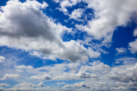 heavenly: White fluffy clouds on heavenly blue sky Stock Photo