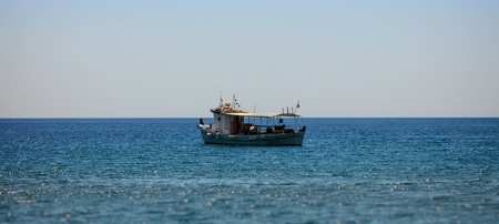 fisher: View on fisher boat on sea against of blue sky