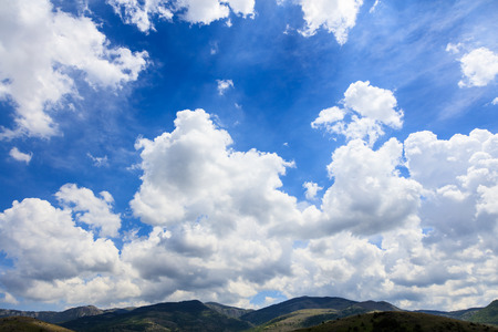 fluffy clouds: Scenic rural background with blue sky and white fluffy clouds Stock Photo