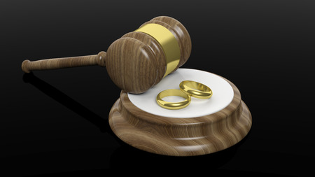 wedding bands: 3D rendering of wooden gavel and two gold wedding bands, isolated on black background.