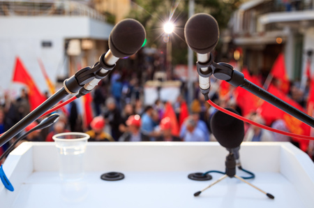 Crowd with red flags abstract background - Microphone close up