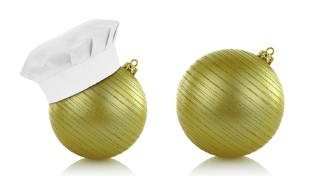 Green christmas balls and chef hat isolated on white background