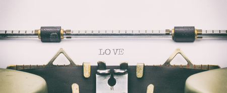 Close-up of LOVE word on a typewriter sheet