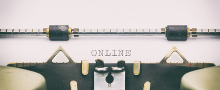 Close-up of word ONLINE on a typewriter sheet Stock Photo