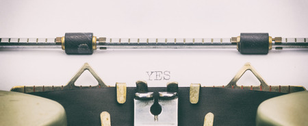Close-up of word YES on a typewriter sheet Stock Photo