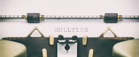 Close-up of BULLYING word on a typewriter sheet