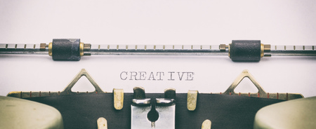 Close-up of word Creative on a typewriter sheet