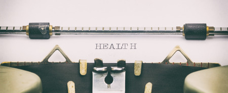 Close-up of HEALTH word on a typewriter sheet