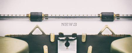 Close-up of word NEWS on a typewriter sheet