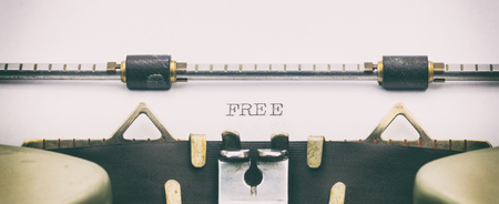 Close-up of word FREE on a typewriter sheet