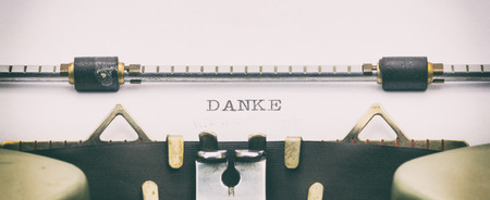 Close-up of of word DANKE on a typewriter sheet