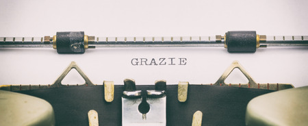Close-up of of word GRAZIE on a typewriter sheet