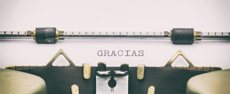 Close-up of of word GRACIAS on a typewriter sheet Stock Photo