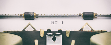 Close-up of word HI on a typewriter sheet