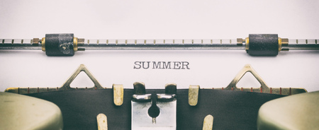 Close-up of word Summer on typewriter sheet