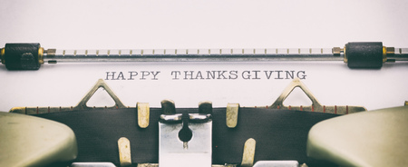 Close-up of HAPPY THANKS GIVING on a typewriter sheet