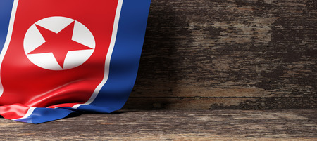 North Korea flag on a wooden background. 3d illustration