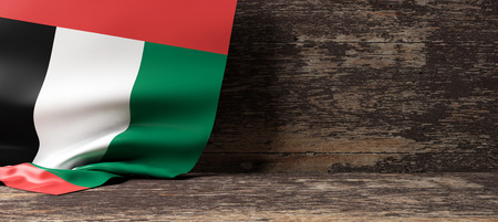 United Arab Emirates flag on a wooden background. 3d illustration Imagens - 85490178