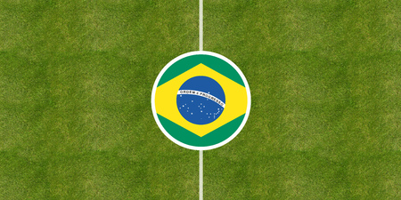 Brazil flag on a soccer field center, top view