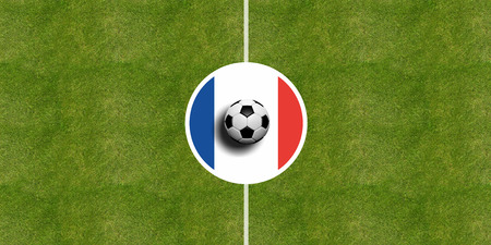 France flag on a soccer field center, top view Stock Photo