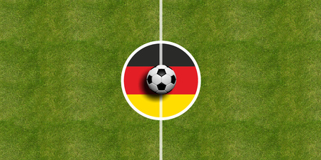 Germany flag on a soccer field center, top view