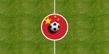 China flag on a soccer field center, top view