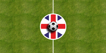 United Kingdom flag on a soccer field center, top view
