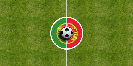 Portugal flag on a soccer field center, top view